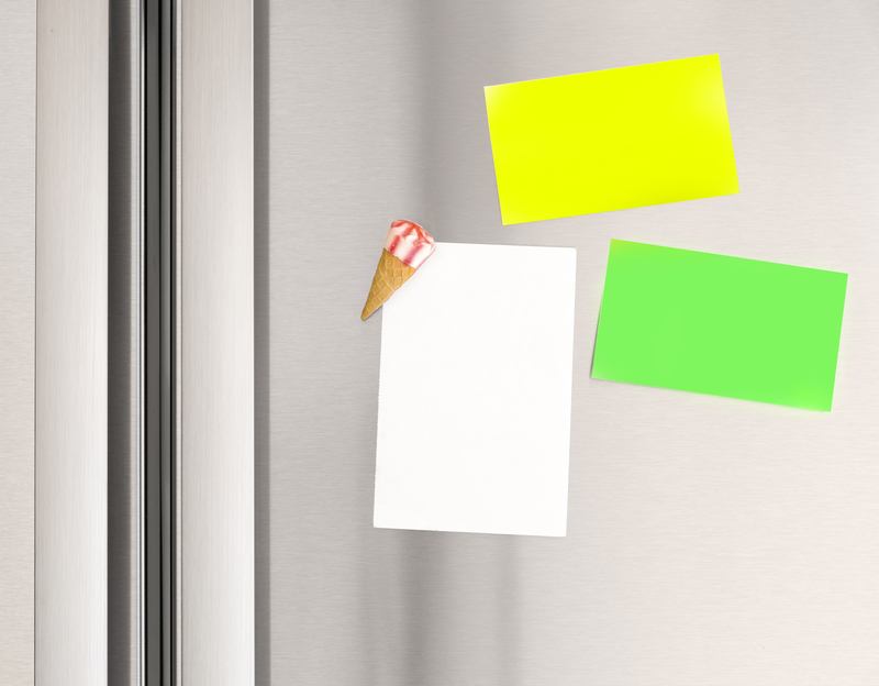 Colorful sticky notes on the fridge at home, abstract domestic background, paper for message, communication concept